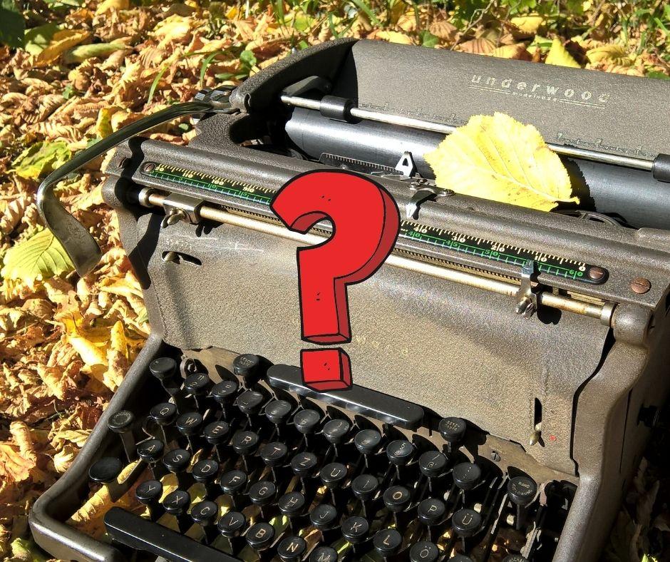 Schreibmaschine mit Fragezeichen